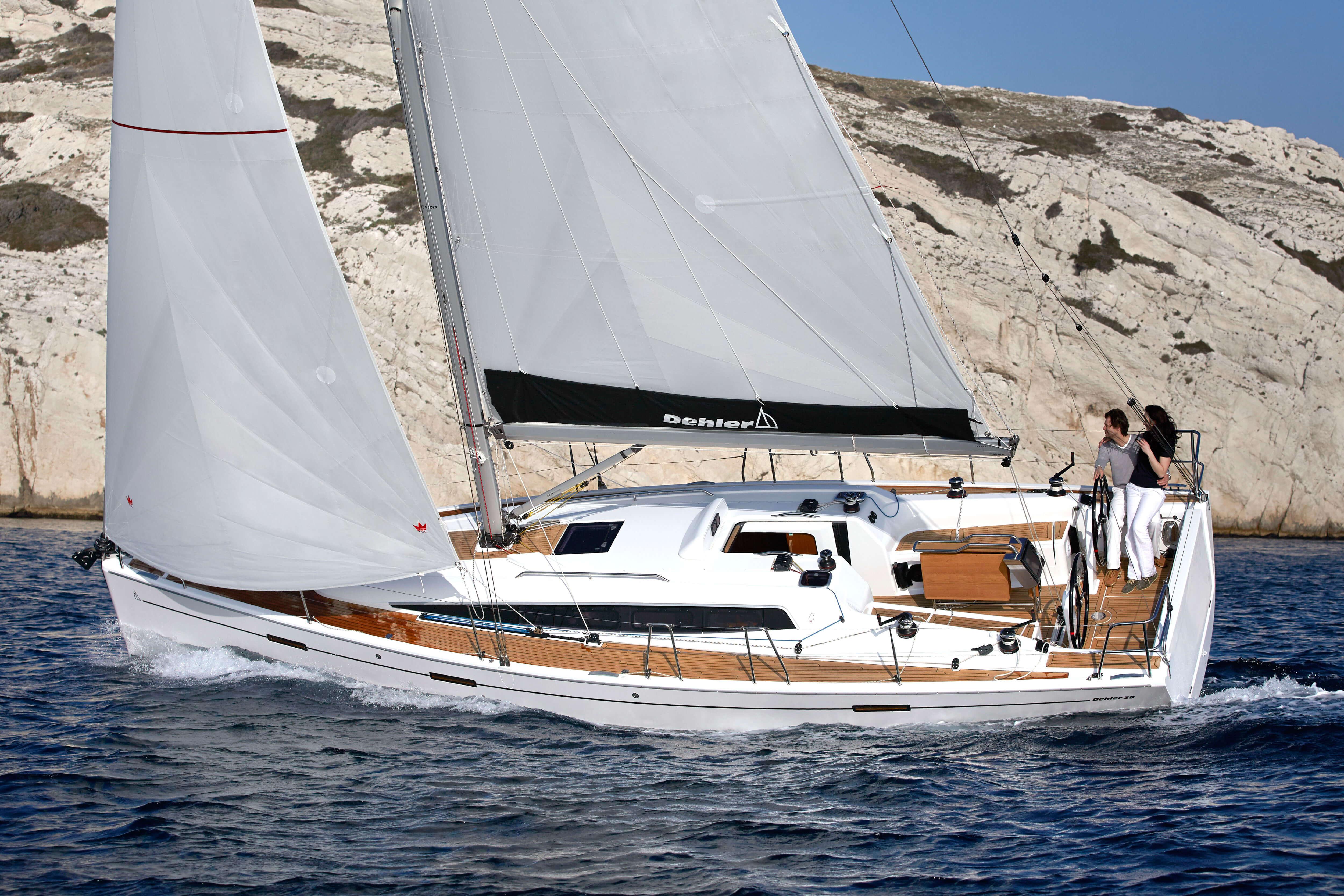 Dehler 38 Exterior Sailing | mainsail, foresail, teak deck, cockpit | Dehler