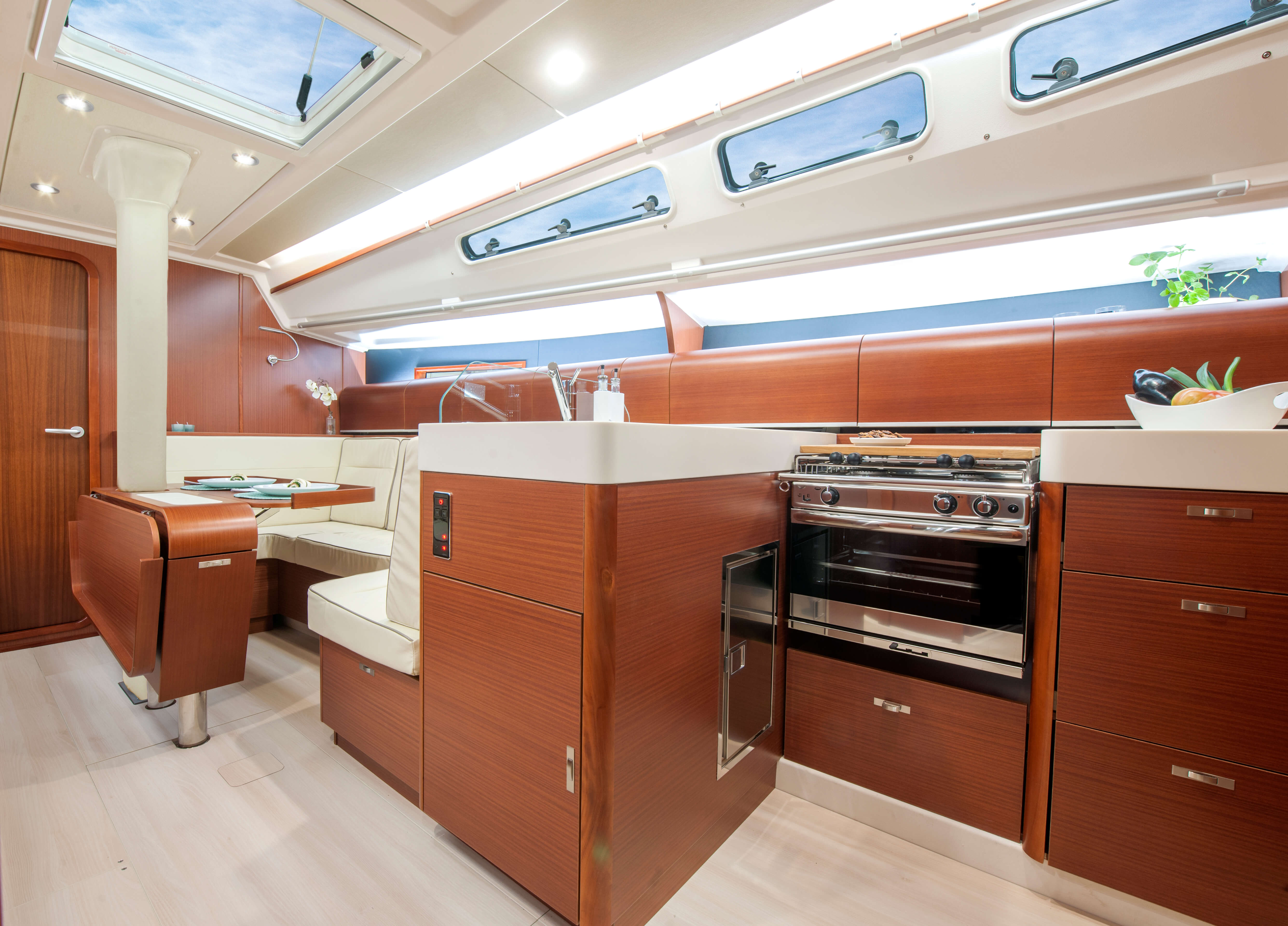 Dehler 42 Interior view lounge | sitting area, foldable table, stove, fridge, sink | Dehler