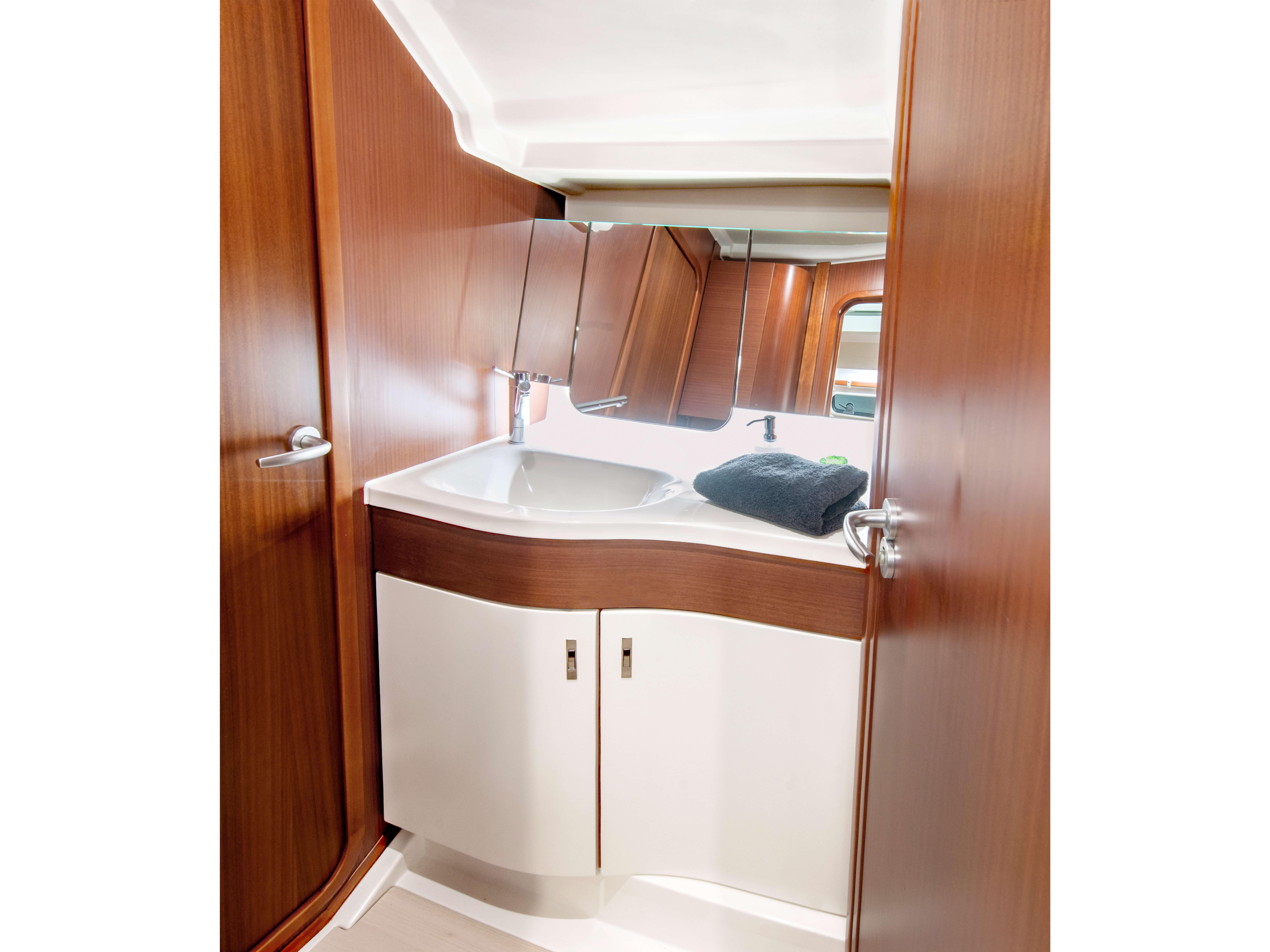 Dehler 42 Interior view wet cell | mahogany, sink, mirror, storage compartmen | Dehler