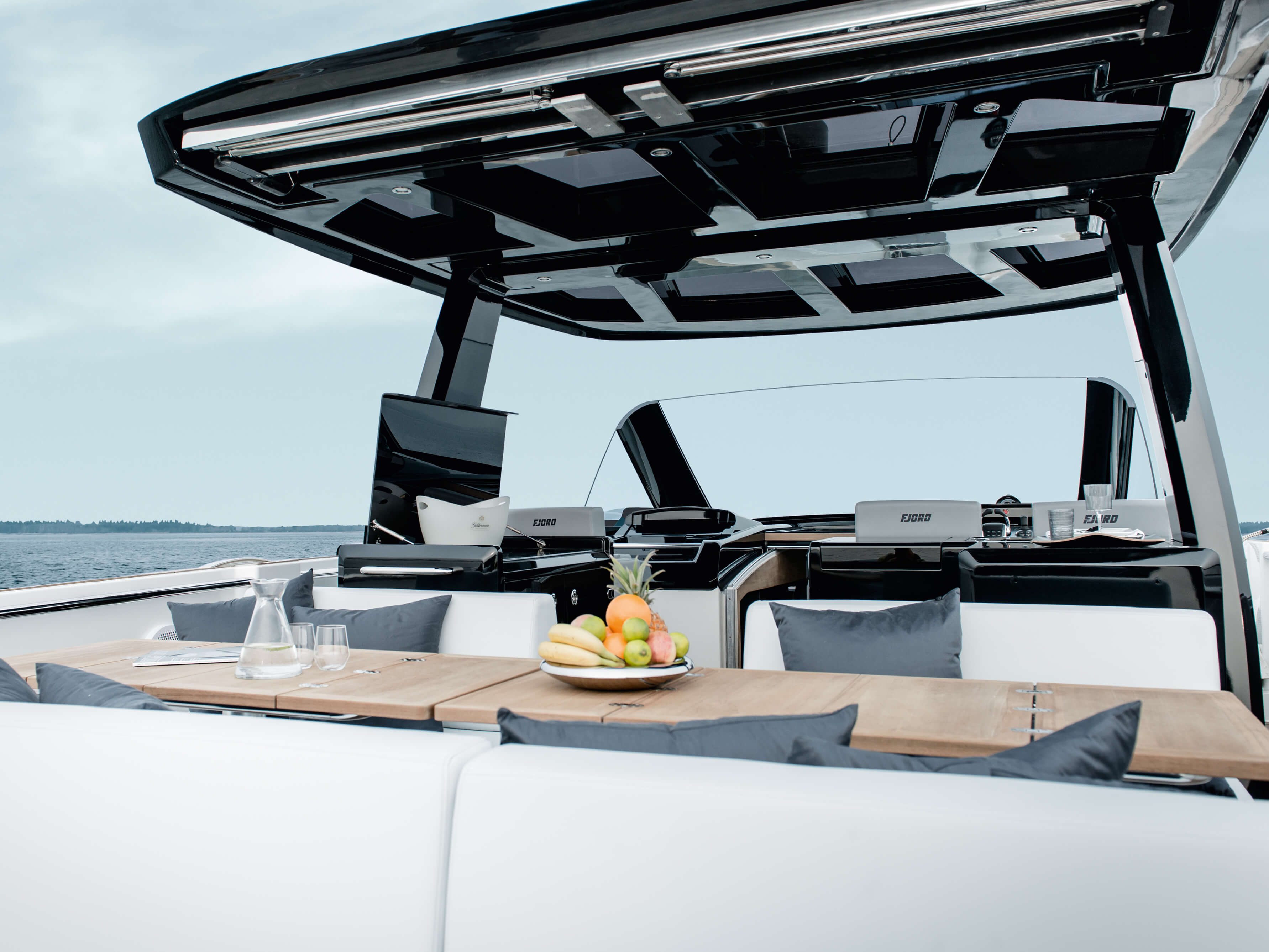 Fjord 48 open Exterior at anchor | T-top with skylights, seating area with folding table convertible to sunbed | Fjord