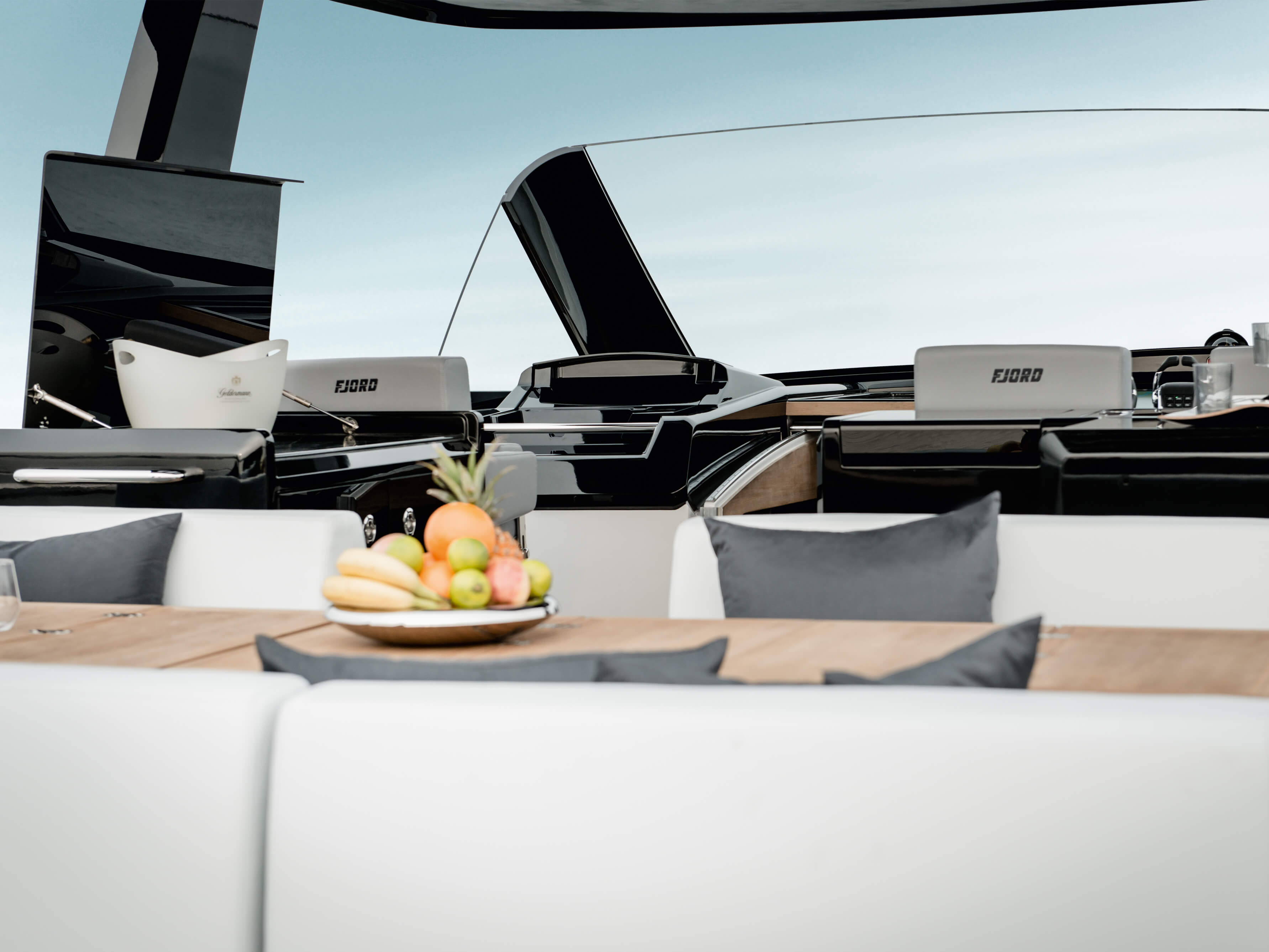 Fjord 48 open Exterior at anchor | sitting area with folding table convertible to sunbed, dashboard, galley | Fjord