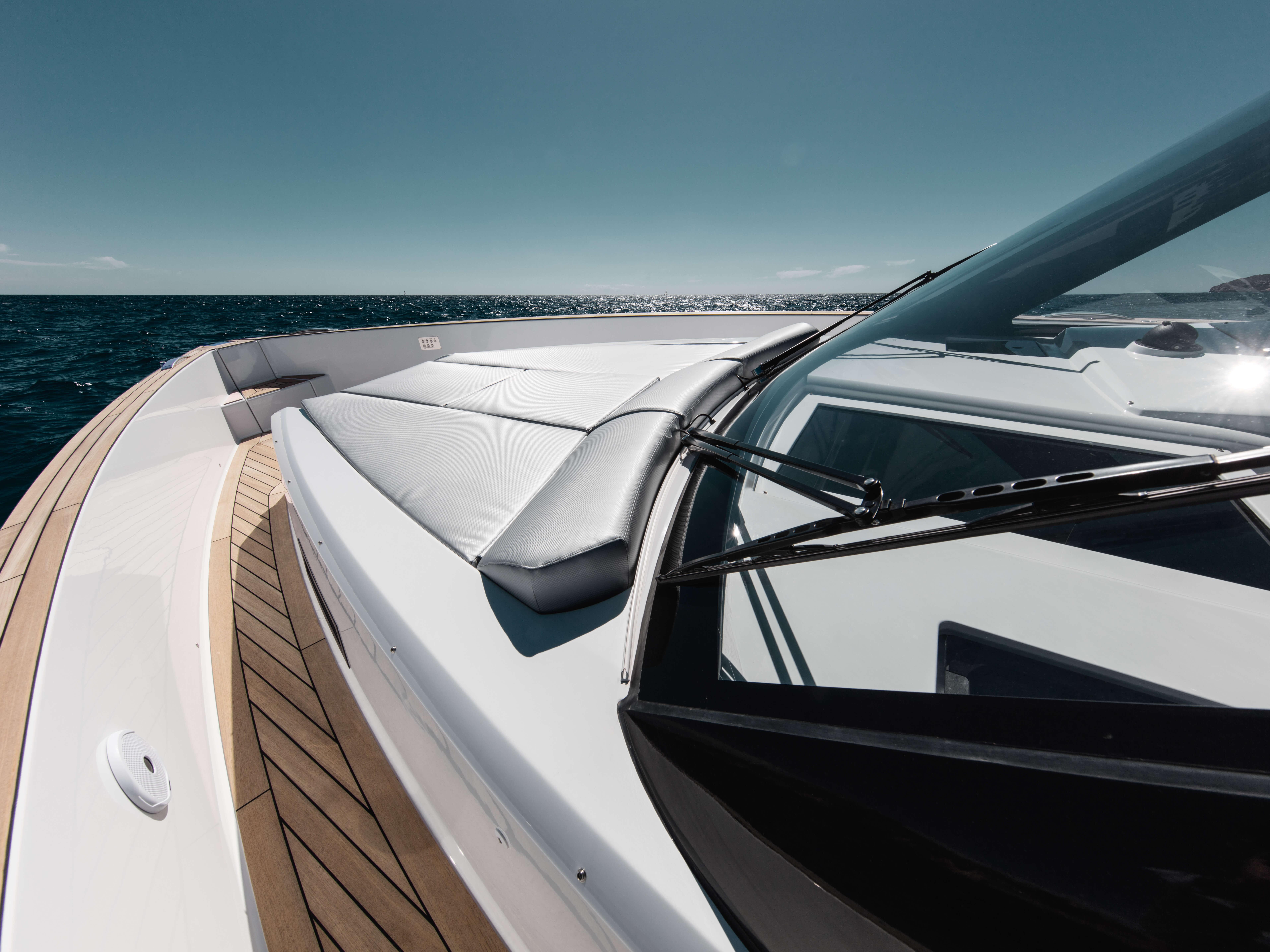 Fjord 48 open Exterior at anchor | teak on side deck and foredeck, fordeck sunbed | Fjord