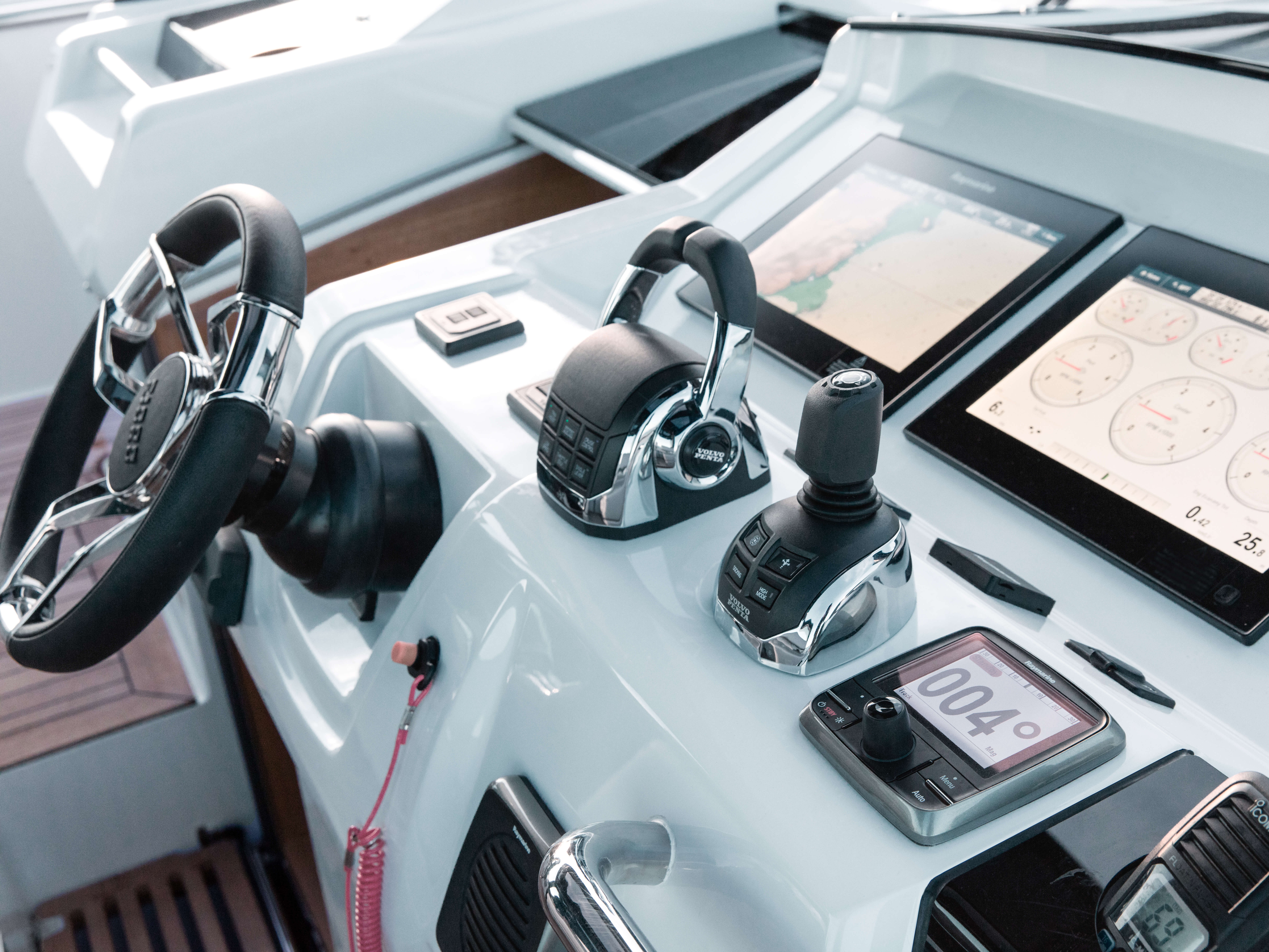 Fjord 48 open Exterior at anchor | dashboard, steering wheel, gas lever, Raymarine high end glass GPS chart plotter | Fjord