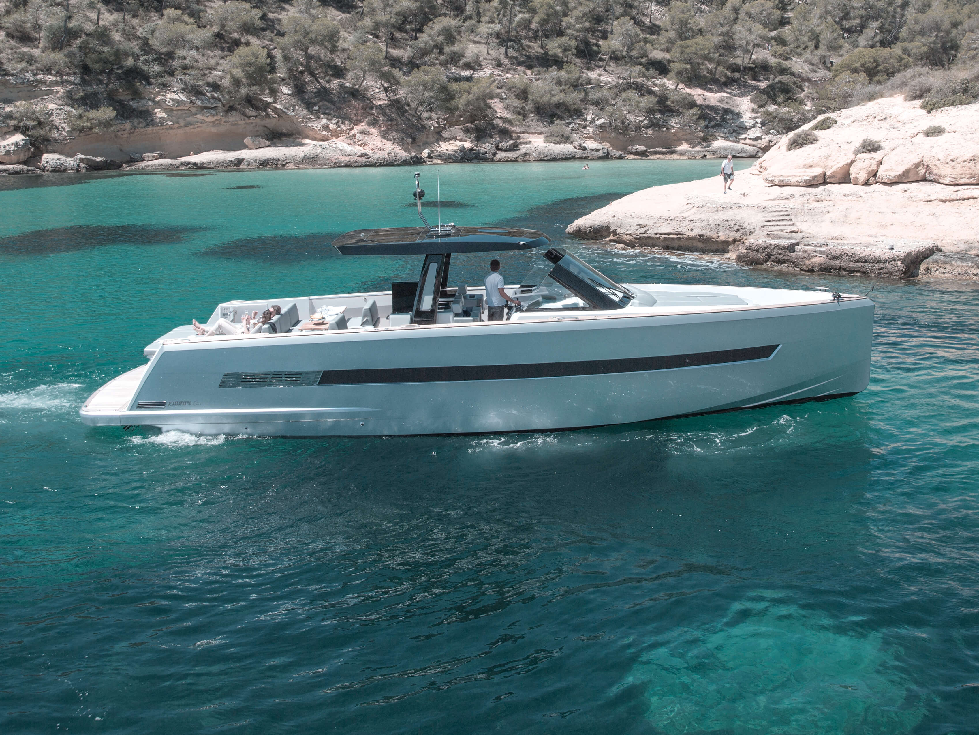 Fjord 48 open Exterior ride | painted hull, T-top with skylights, bathing platform with teak and hydraulic lift, aft sunbed | Fjord