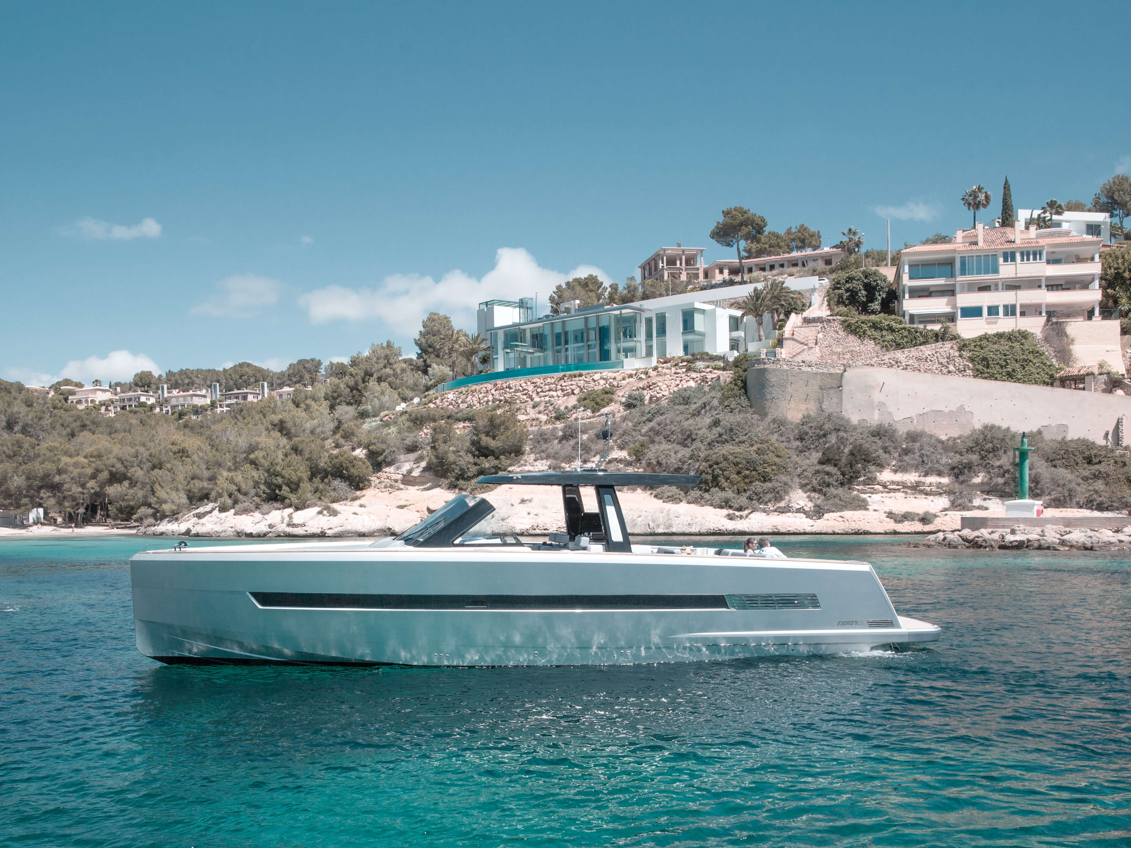 Fjord 48 open Exterior at anchor | painted hull, T-top with skylights | Fjord