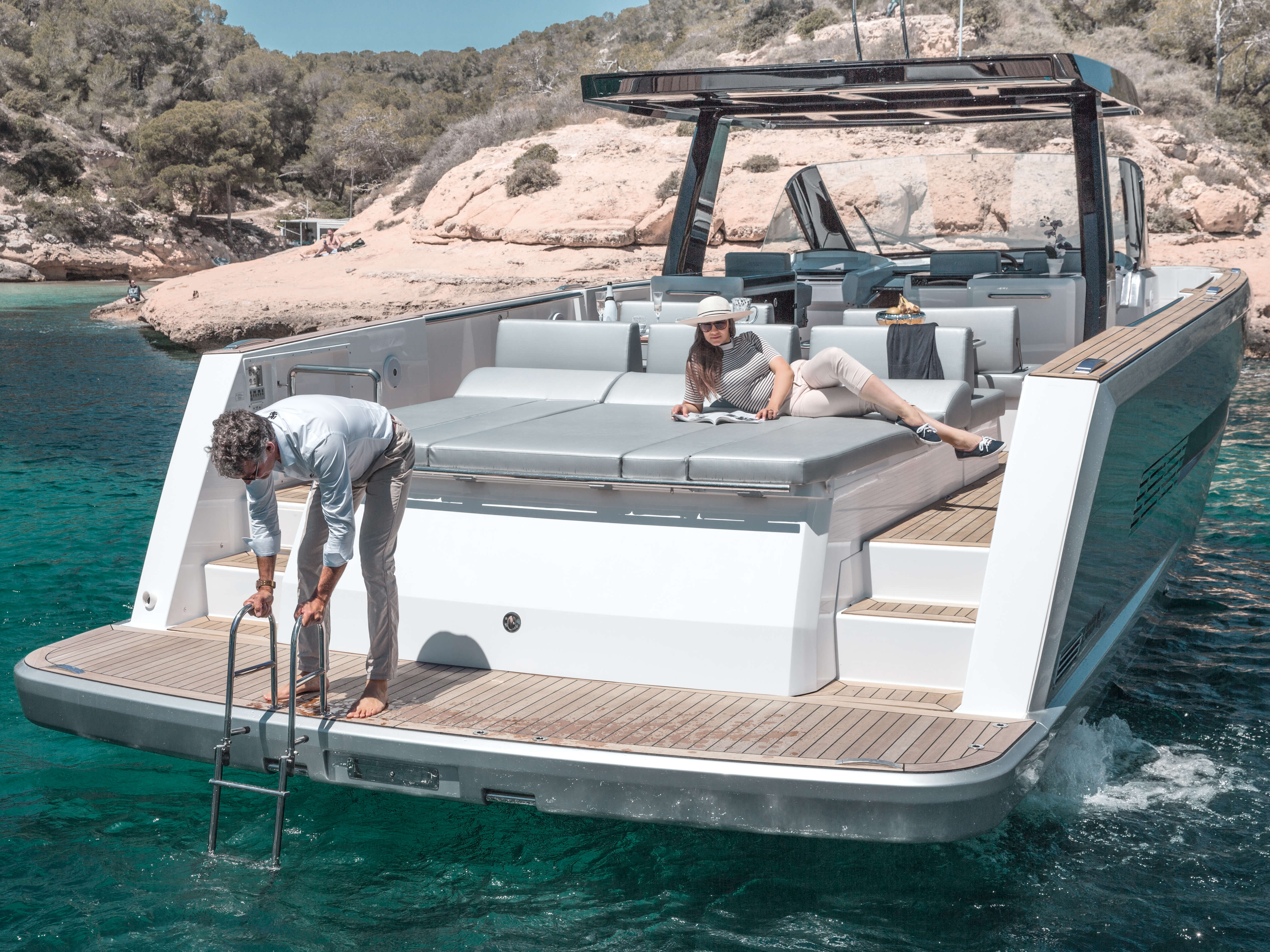 Fjord 48 open Exterior at anchor | bathing platform with teak and hydraulic lift, aft sunbed | Fjord