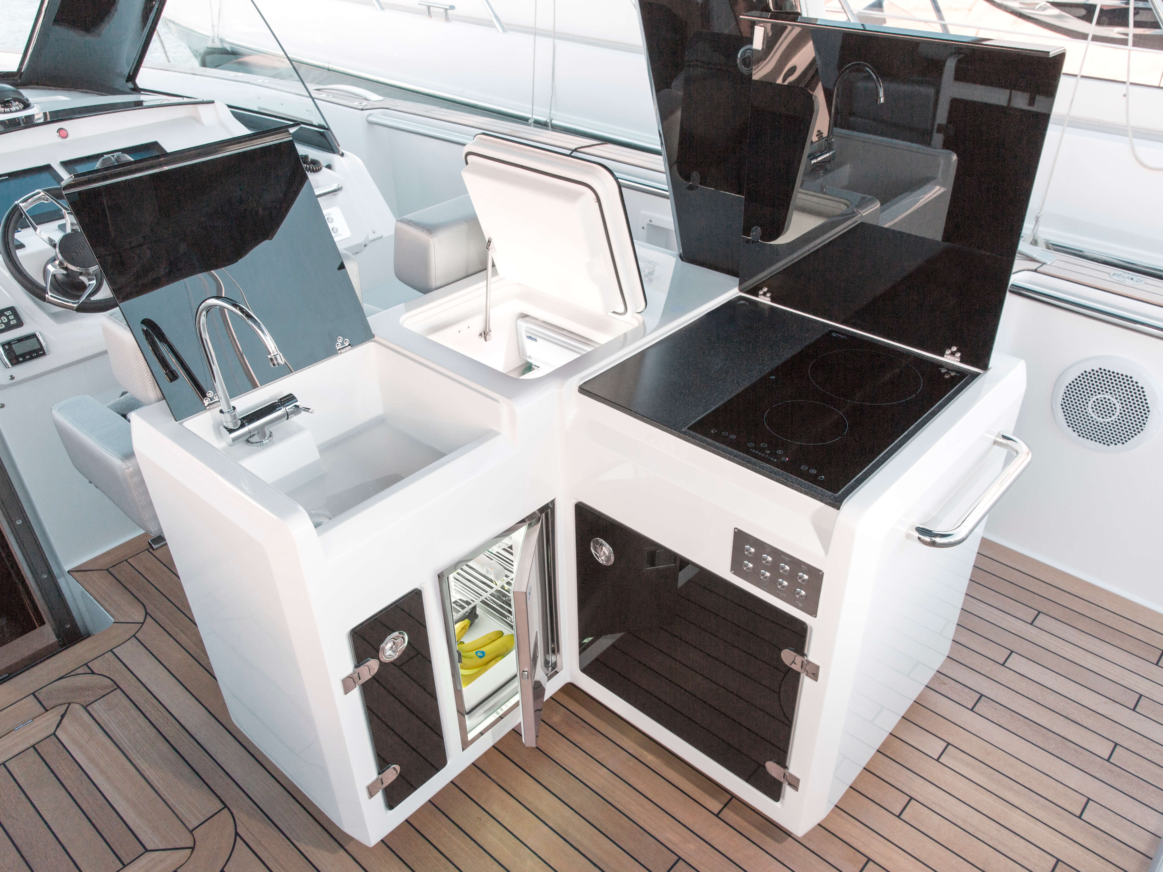 Fjord 48 open Exterior at anchor | galley with front opening fridge and 2 burners stove | Fjord