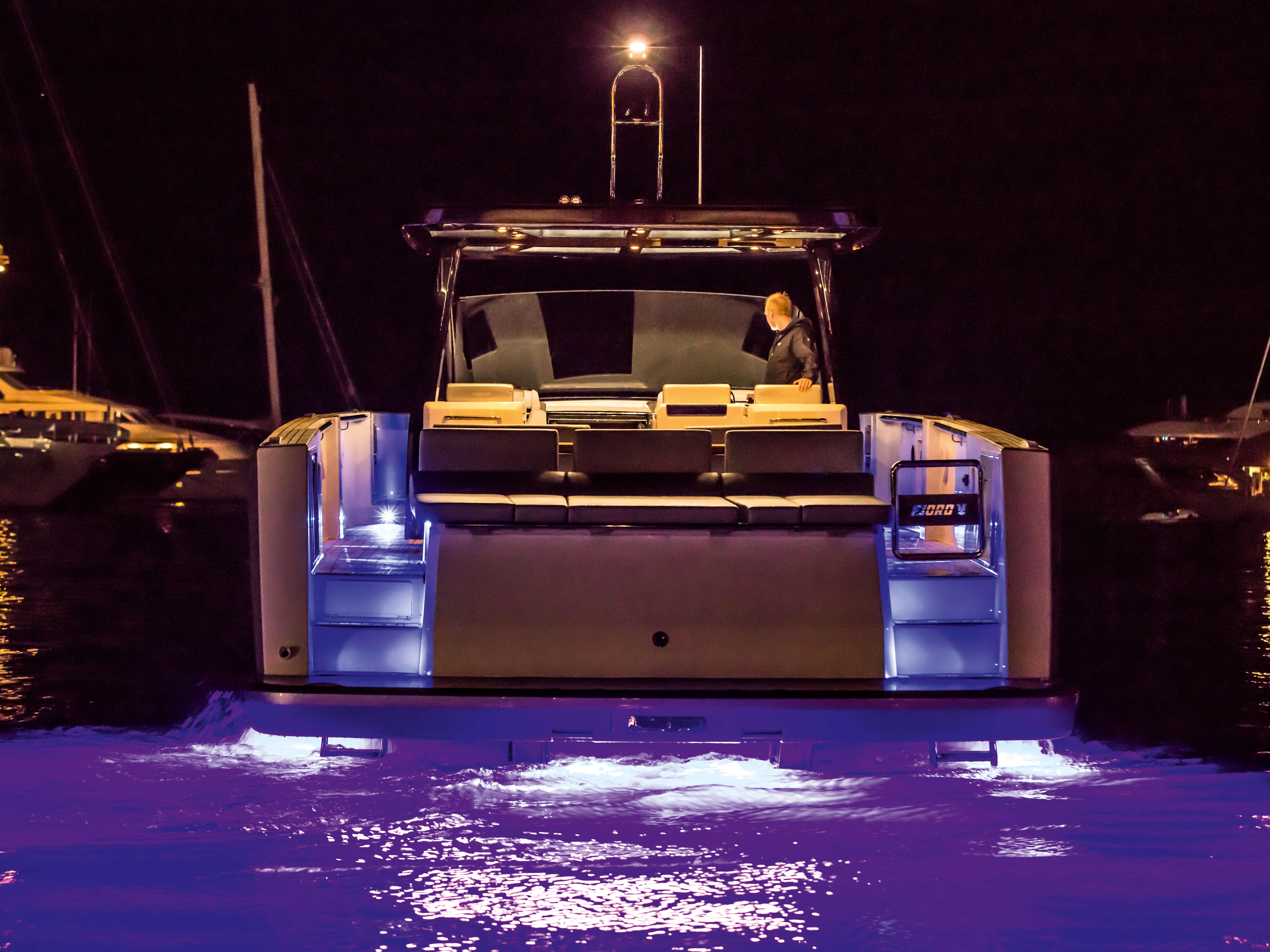 Fjord 48 open Exterior at anchor | bathing platform, aft sunbed, courtesy lights at bulwark, underwater lights | Fjord