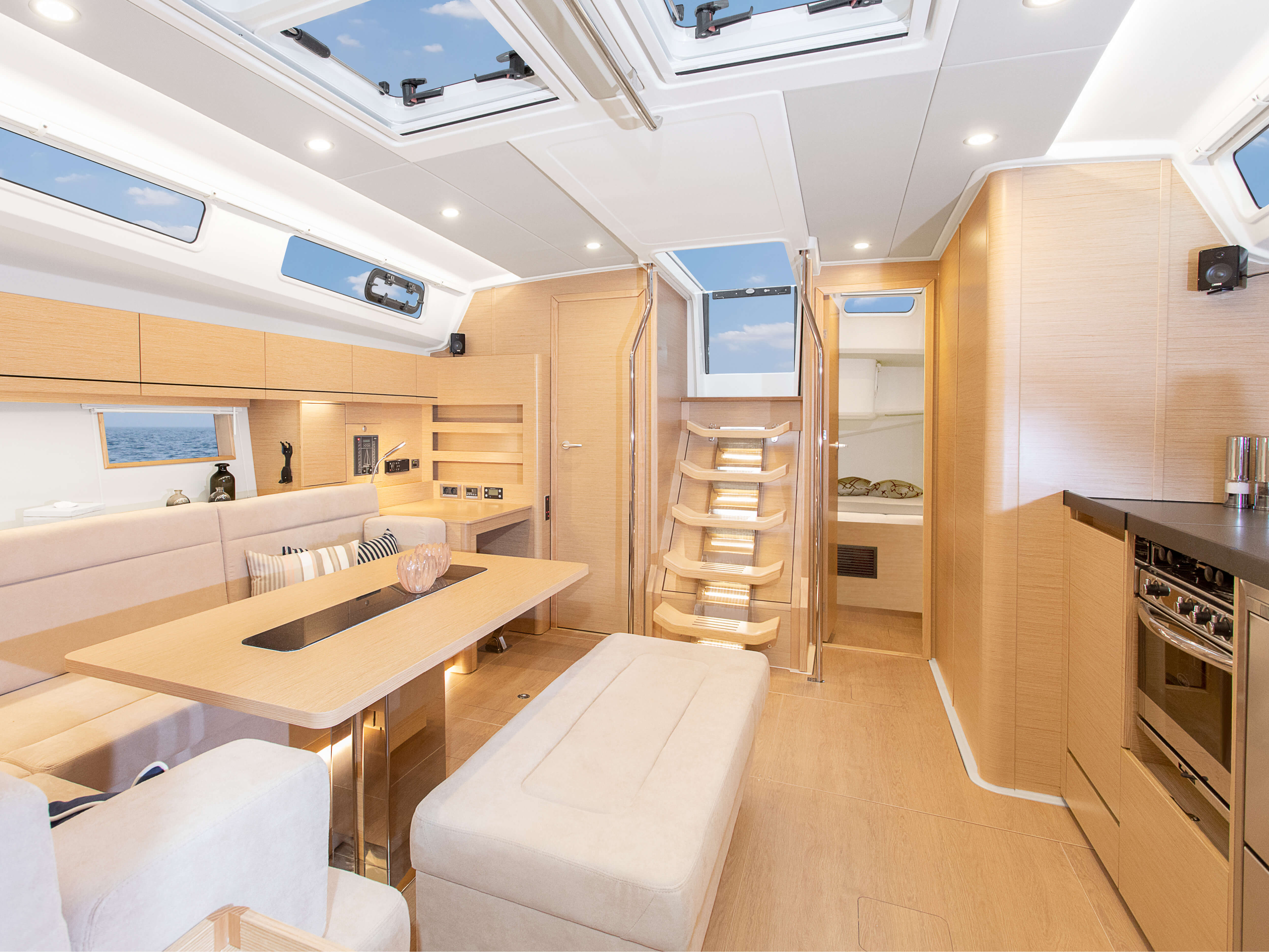 Hanse 508 | Thanks to various layout variants and a large selection of combination options – with high-quality fabrics, fine woods, trendy colours, select floorings and stylish furnishings – you can make your HANSE your own, a very personal one-of-a-kind yacht. | Hanse