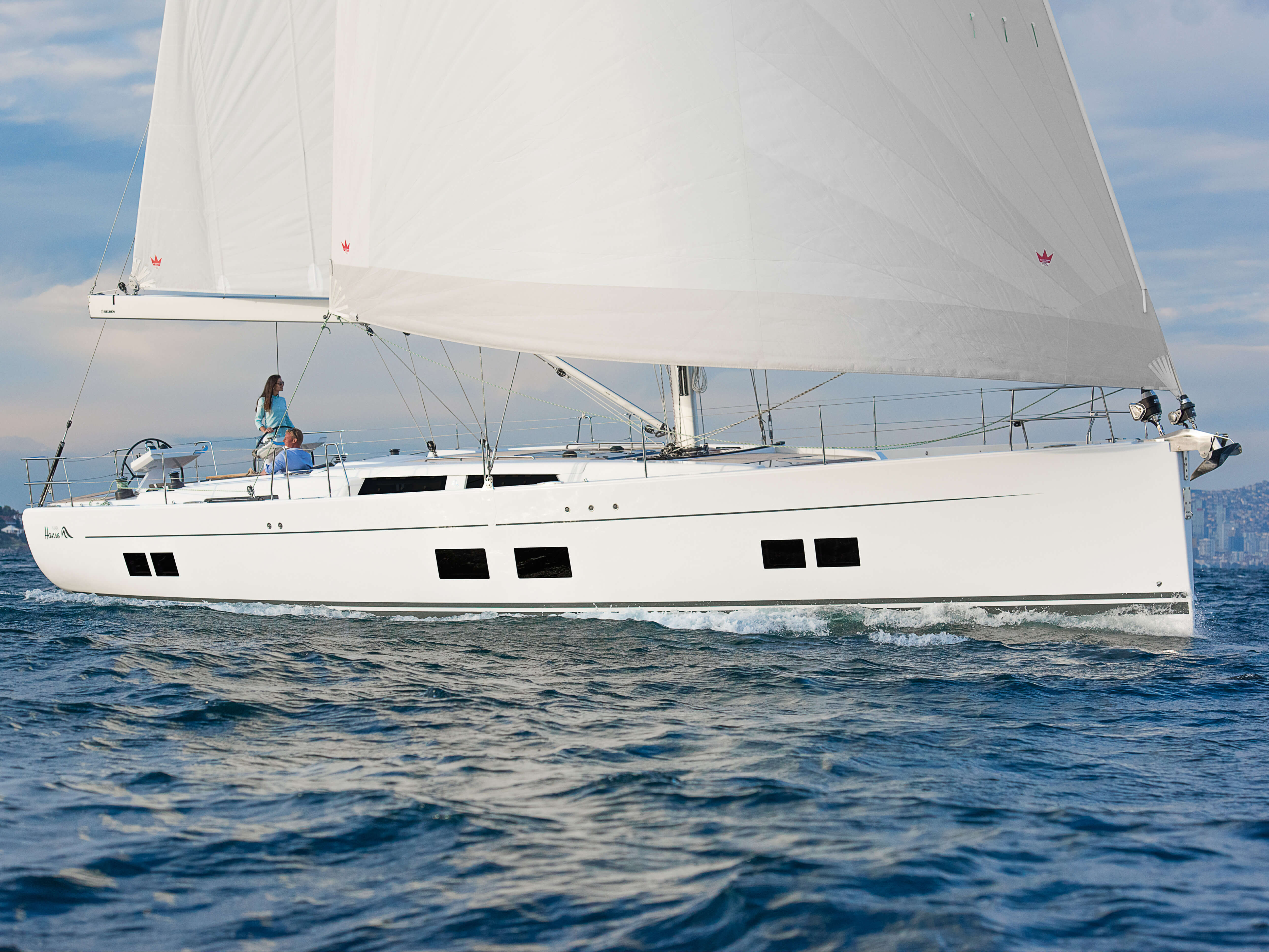 Hanse 588 Exterior Sailing | mainsail, Genoa, cockpit, double steering wheel, rail | Hanse