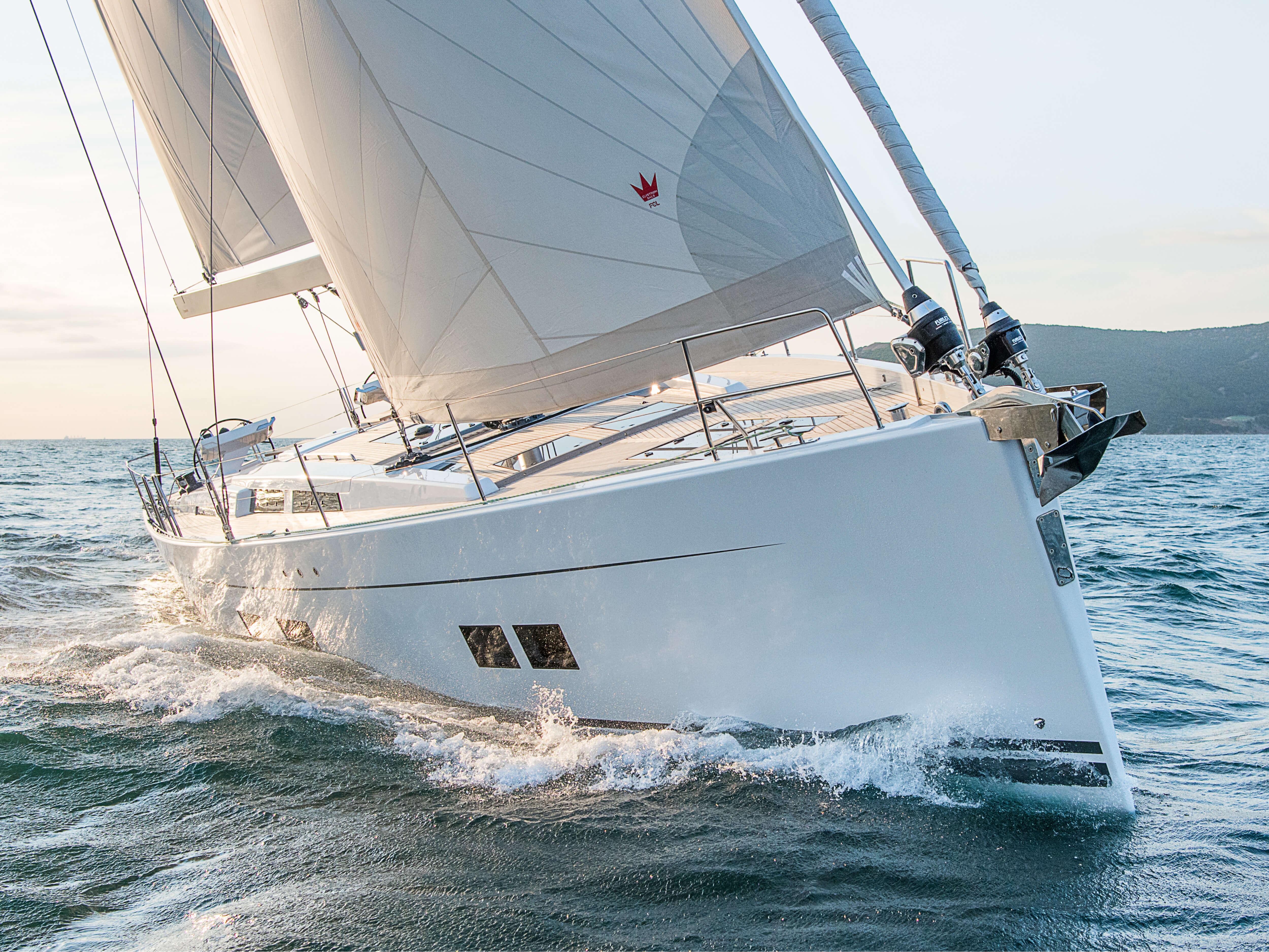 Hanse 588 Exterior Sailing | foresail, main sail, hand rail, teak deck | Hanse