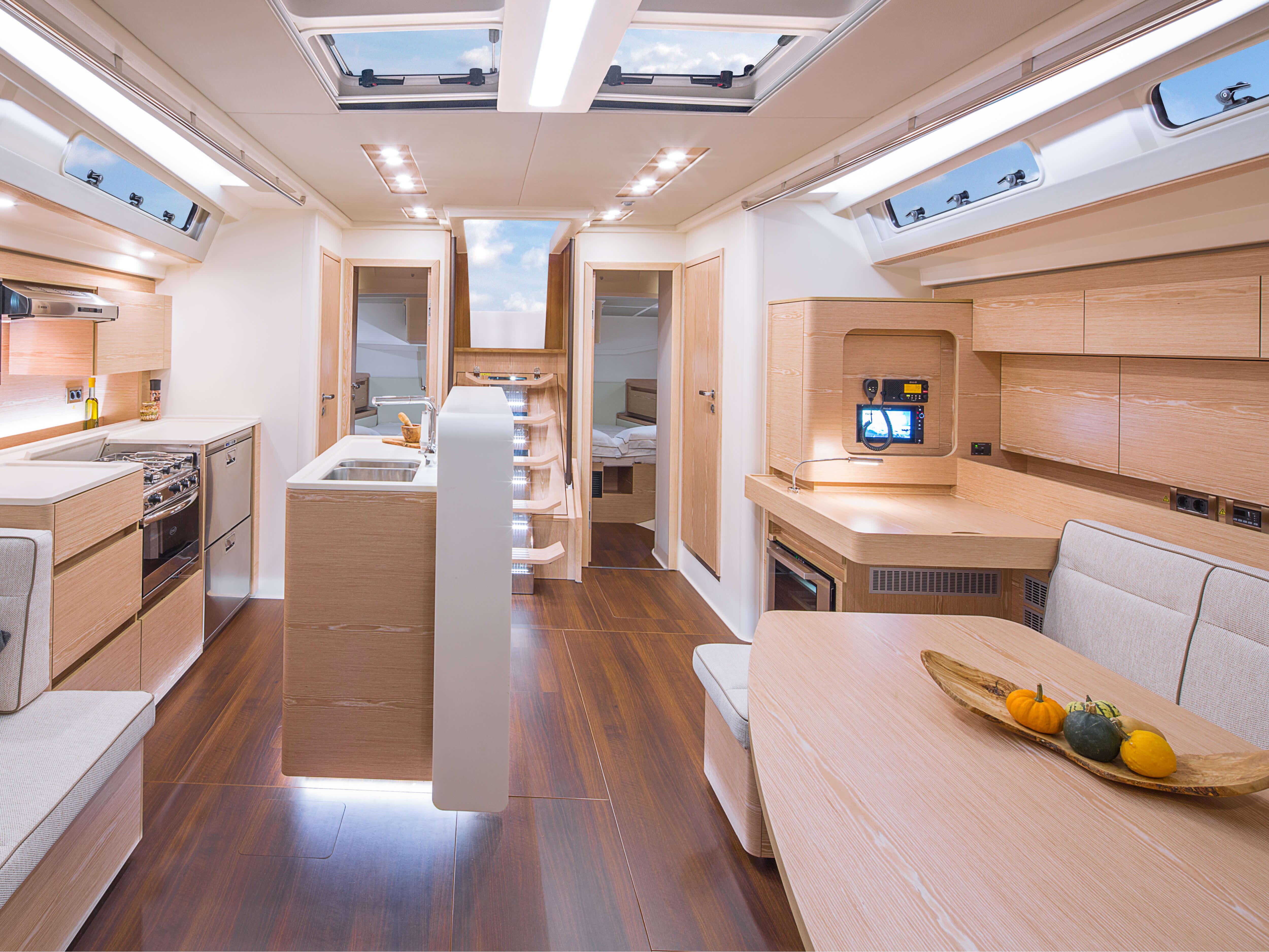 Hanse 588 | sink, oven, companion way, pantry, sitting area, navigation corner | Hanse