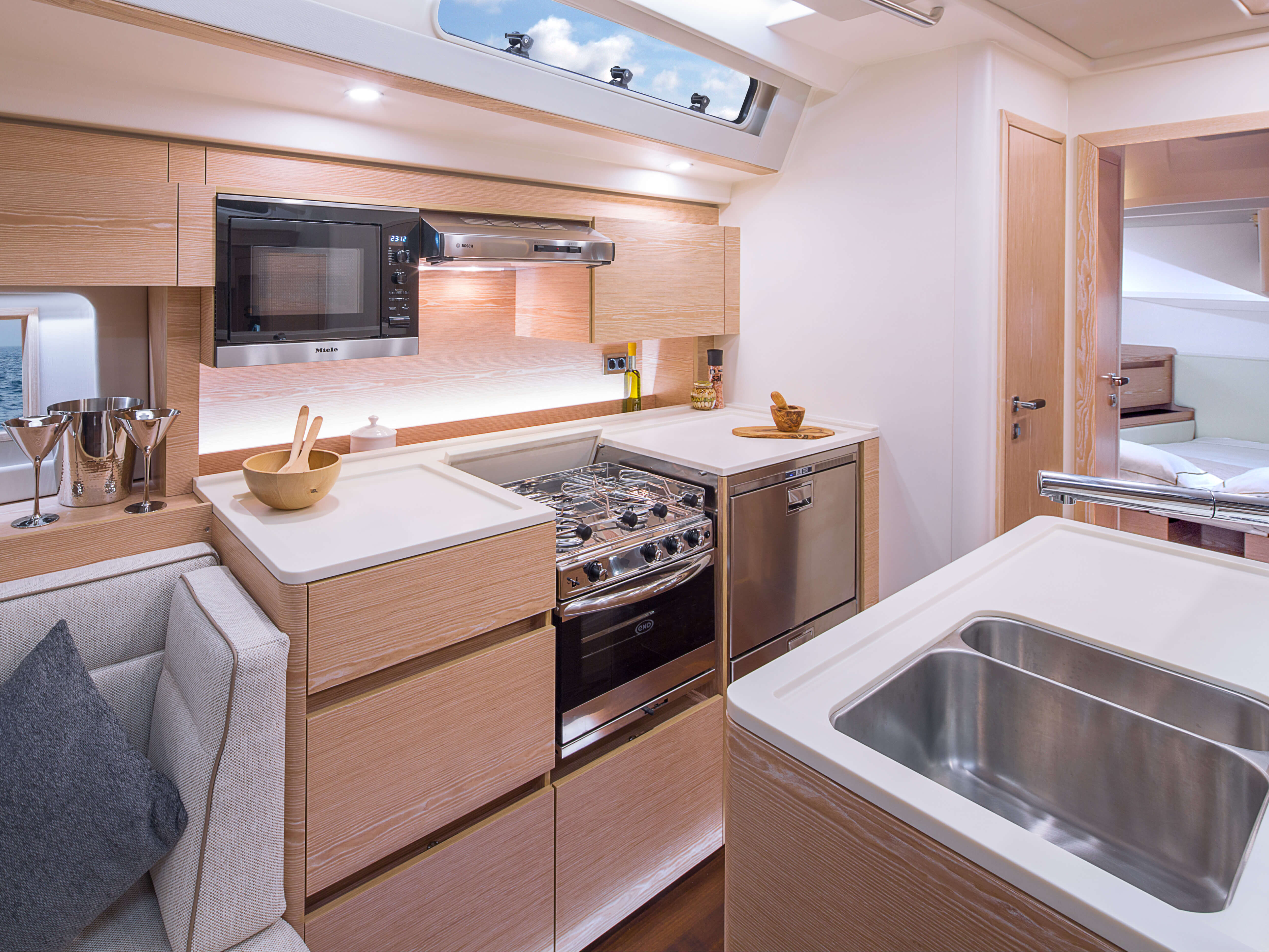 Hanse 588 | Pantry with sink, oven, cooling bos, storage compartment, deposit area | Hanse