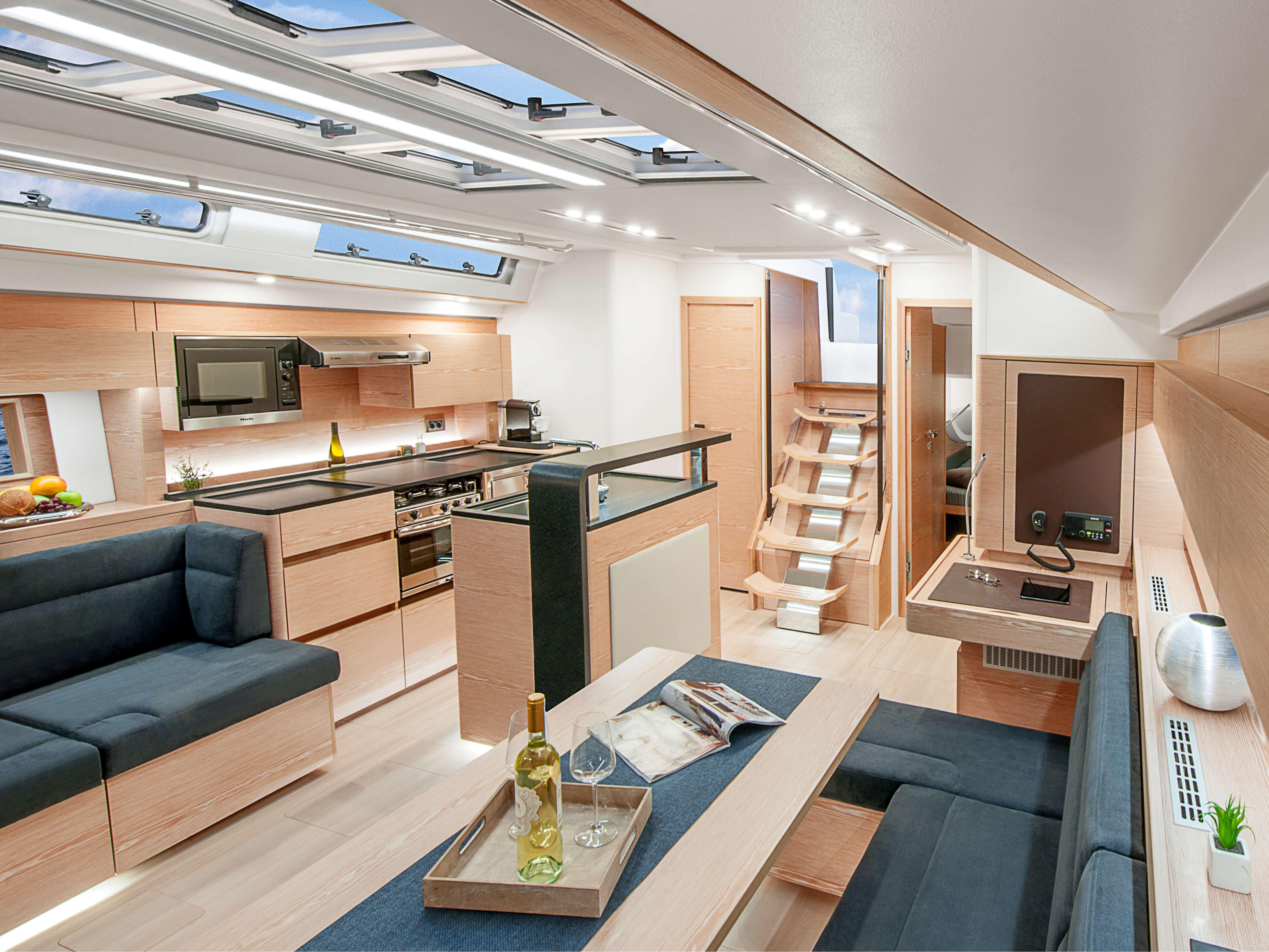 Hanse 588 | lounge area, pantry, navigation corner, companion way | Hanse