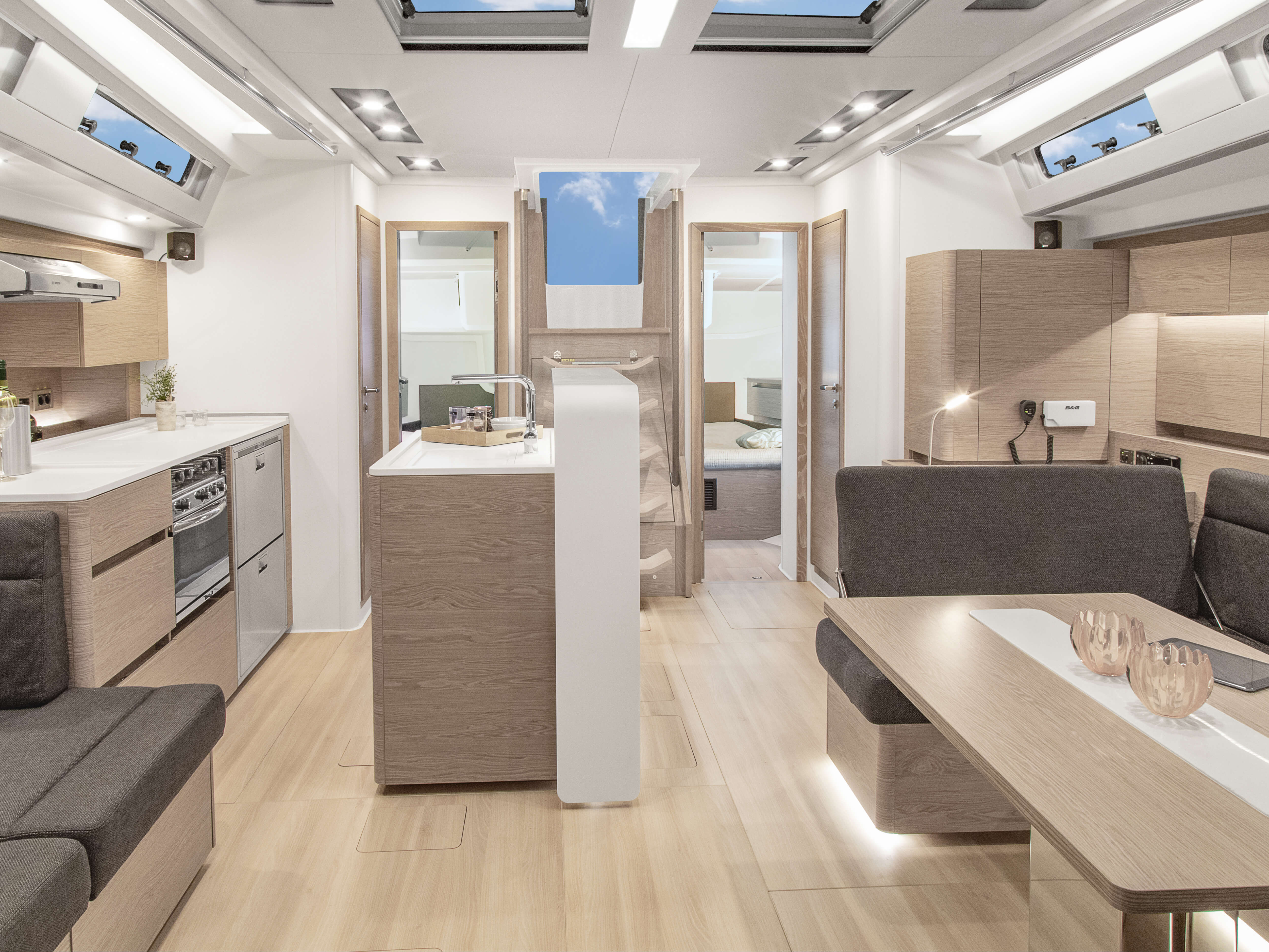 Hanse 588 | Thanks to various layout variants and a large selection of combination options – with high-quality fabrics, fine woods, trendy colours, select floorings and stylish furnishings – you can make your HANSE your own, a very personal one-of-a-kind yacht. | Hanse