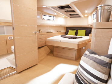 FJORD 40 open cabin | Even with the sundeck cushions above the skylights, there is still plenty of light streaming in through the hull windows. | Fjord