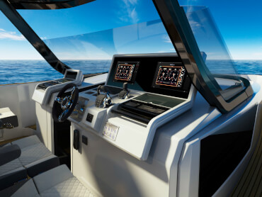 FJORD 41 XL | The state-of-the-art glass-bridge helm console is complemented by the largest single-piece windscreen in its class. | Fjord