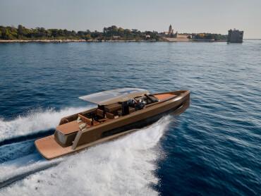 A stylish powerboat cruises along the coastline