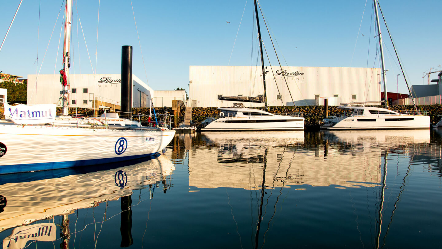 New luxury sailing yachts at dock outside of factory