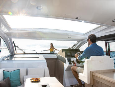 Sealine C330v helm   Enjoy 360 degree views from the helm station thanks to the large windshield and side windows.   Sealine