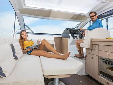 Sealine C330v saloon   Lower the saloon table, pad it with cushions and create a generous area for reclining.   Sealine