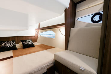 Sealine C330v guest cabin   Rich materials are found throughout including warm woods, leather and chushions in the colour of your choice.   Sealine