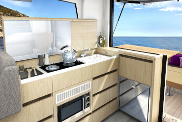 Sealine C335v | The L-shaped galley is located beetween the saloon and the cockpit to comfortably serve both areas. | Sealine
