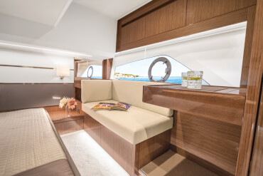 Sealine C430 owner's cabin | The lighting system with dimming function adapts the ambience to match your every mood. | Sealine