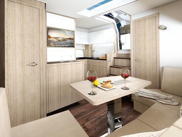 Sealine S430 Salon | Mit der Galley direkt gegenüber des Salontisches werden Sie beim Kochen nie allein sein. | Sealine