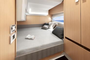 powerboat, cabin, interior, natural light, window, bed, berth, cupboard