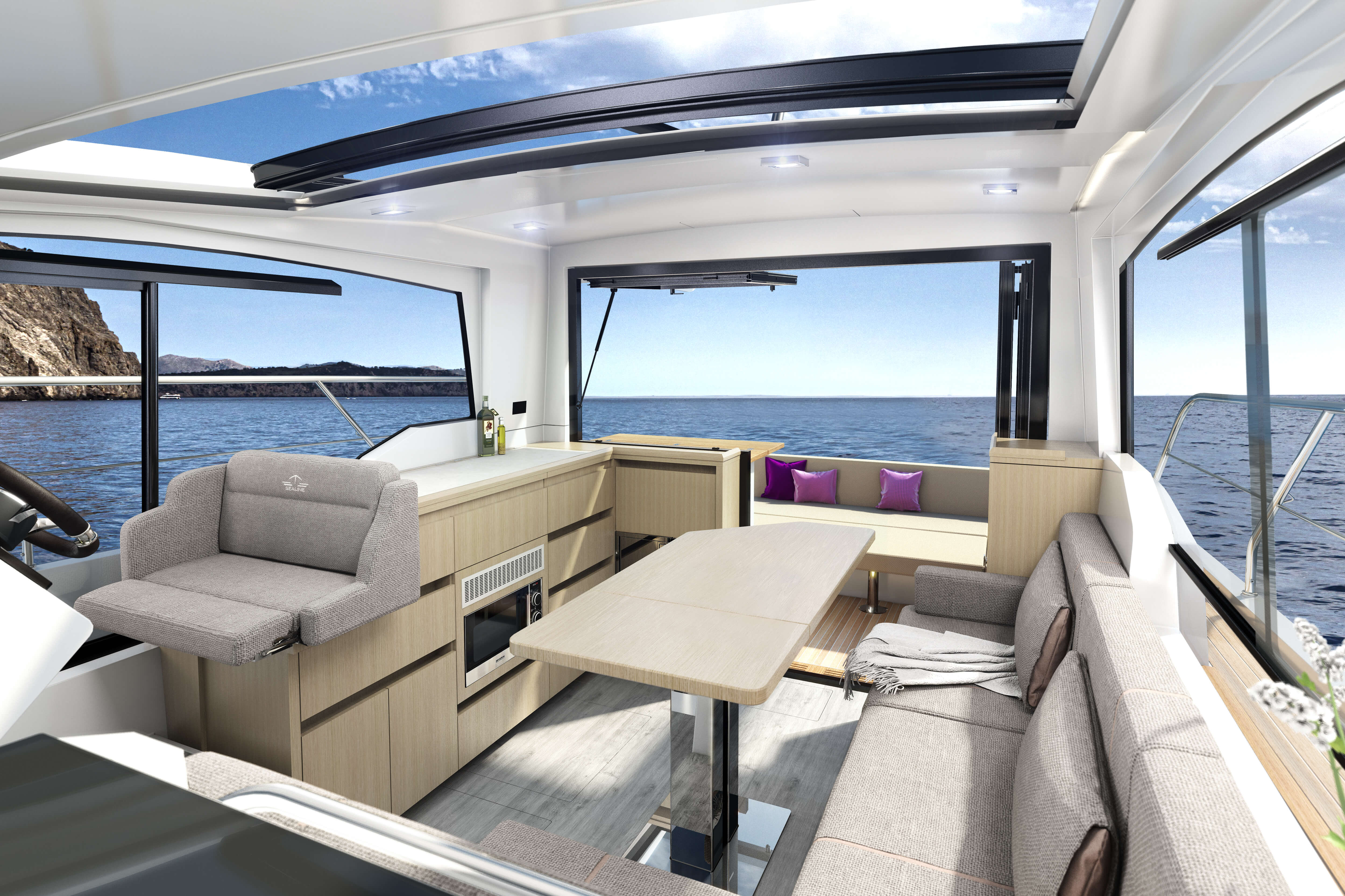 Sealine C335 saloon | Large windows and the bifold door provide abundant natural light - as well as wonderful views to the maritime scenery beyond. | Sealine