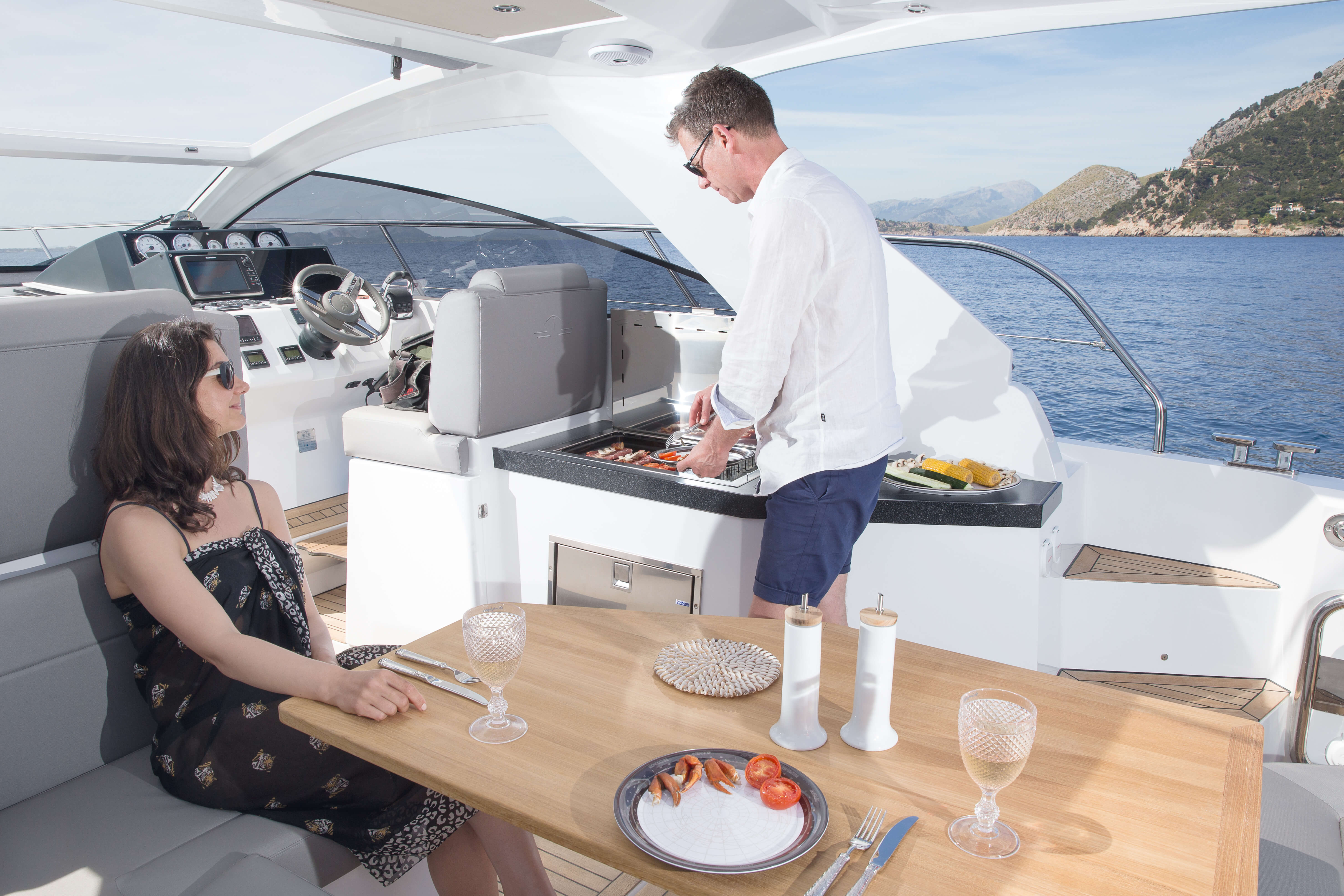 Exterior at anchor | lounge area, table | Sealine